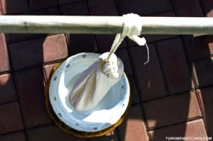 straining yogurt using a cotton bag