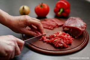 Cut the meat into thin slices and then chop as fine as possible.