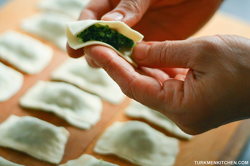 Fold the dough in half and pinch the edges together.
