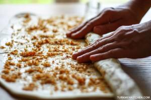 Gradually roll the dough into a tight log.