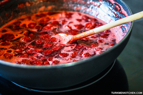 Stir the strawberries over medium heat until the sugar has dissolved.