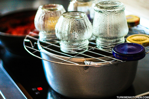 Wash the jars and lids, and place them upside down on a wire rack over a pot of boiling water for 15 minutes.